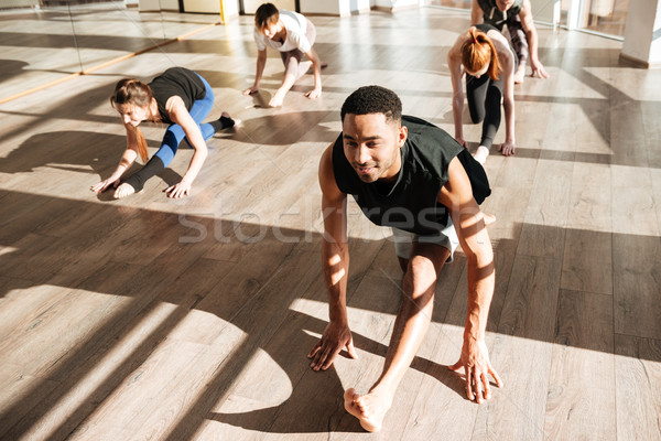 Group of people engaged yoga Stock photo © deandrobot