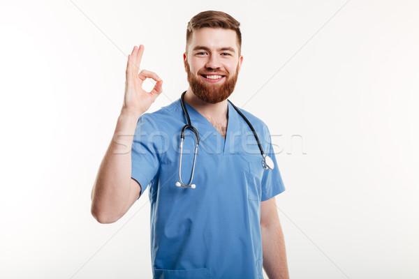Feliz amistoso doctor de sexo masculino estetoscopio Foto stock © deandrobot