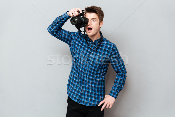 Surprised photographer working isolated Stock photo © deandrobot