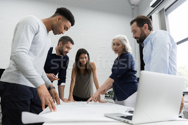 Group of business people discussing financial plan Stock photo © deandrobot