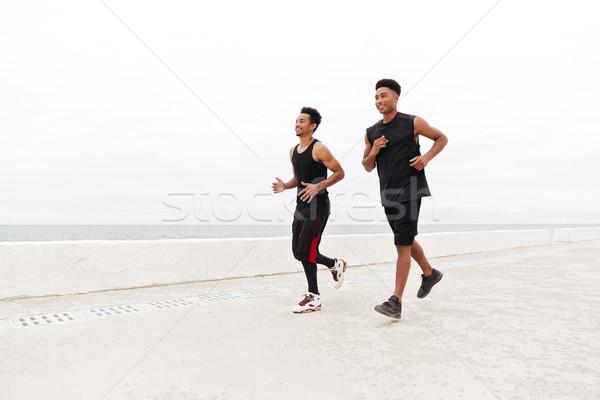 African sports men friends running outdoors Stock photo © deandrobot
