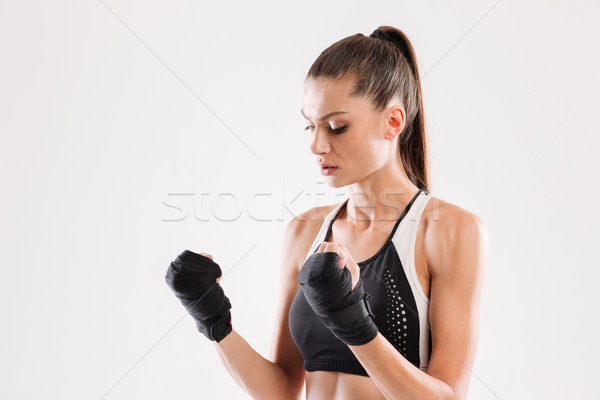 Portrait of a motivated healthy sportswoman Stock photo © deandrobot