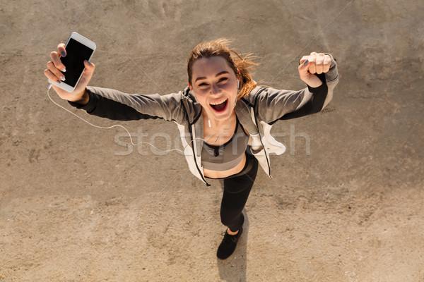 Felső kilátás boldog fiatal sport nő Stock fotó © deandrobot