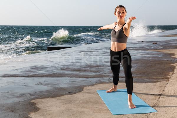 портрет красивой молодые Фитнес-женщины йога синий Сток-фото © deandrobot