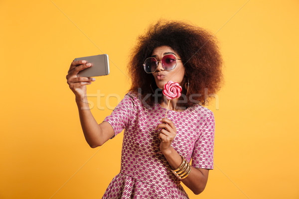 Portrait of a funny young afro american woman Stock photo © deandrobot