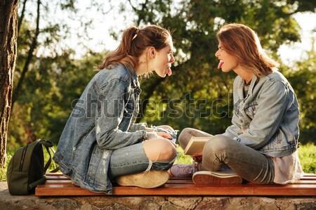 Dois maravilhado mulher jovem smartphones olhando Foto stock © deandrobot