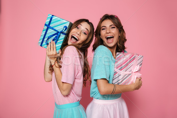 Close-up photo of two overjoyed female friends in colorful tshir Stock photo © deandrobot