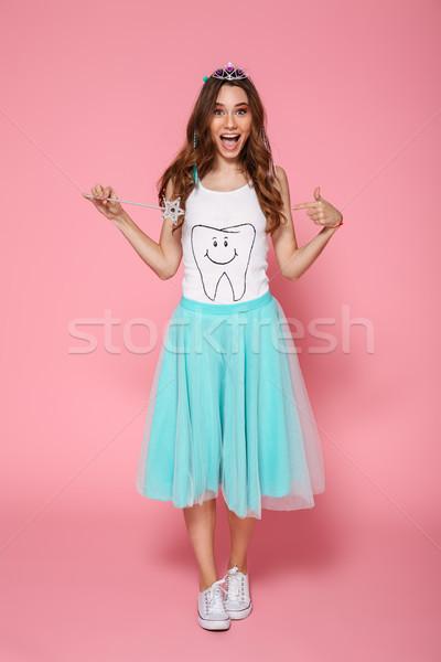 Full length portrait of overjoyed pretty brunette woman dressed  Stock photo © deandrobot