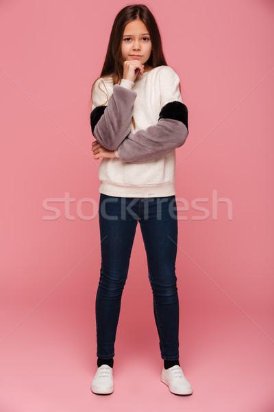Photo pensive fille regarder caméra isolé Photo stock © deandrobot