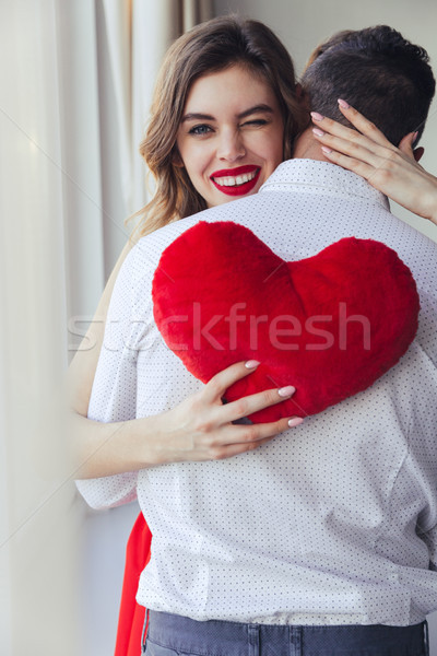 Portrait of a smiling young woman holding her boyfriend Stock photo © deandrobot