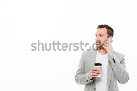 Portrait of male office worker drinking takeaway coffee while ha Stock photo © deandrobot