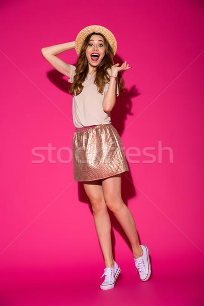 Mutlu şaşırtıcı genç kadın görüntü şapka Stok fotoğraf © deandrobot