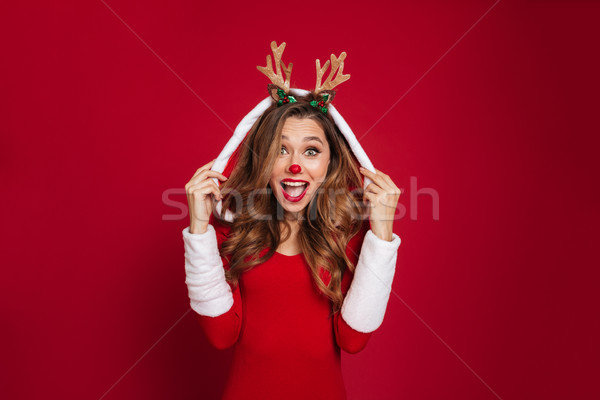 Portrait of a cheerful young girl Stock photo © deandrobot