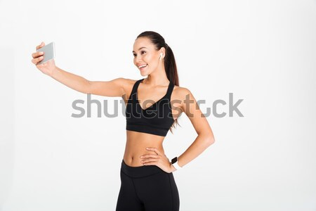 Stock photo: Portrait of a smiling asian fitness woman in earphones