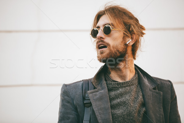 Portrait of an attractive bearded man wearing sunglasses Stock photo © deandrobot