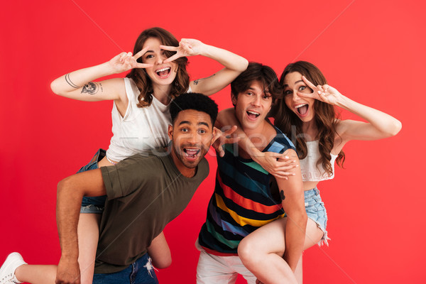 Portrait of a cheerful happy group of multiracial friends Stock photo © deandrobot