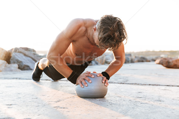Portrait of a fit shirtless sportsman Stock photo © deandrobot