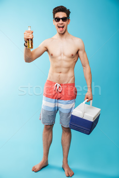 Full length portrait if a happy shirtless man Stock photo © deandrobot