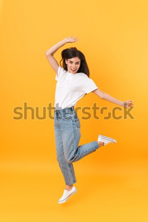 Stock photo: Amazing happy cute young pretty woman listening music with headphones make peace gesture.