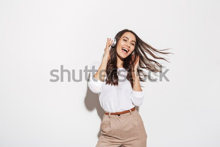 Portrait of a cheery asian businesswoman Stock photo © deandrobot