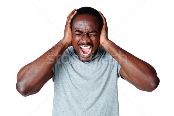 Portrait of african man shouting and closing ear by his hands on white background Stock photo © deandrobot