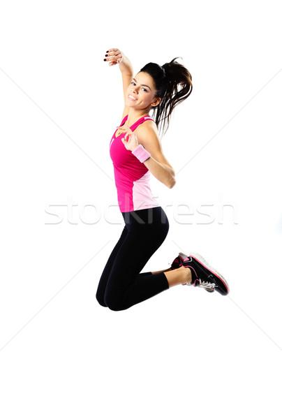 Portret młodych szczęśliwy kobieta skoki Zdjęcia stock © deandrobot