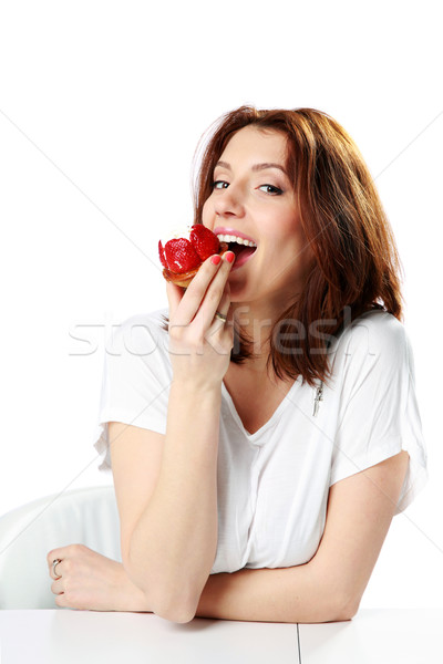 Beautiful woman eating fresh strawberry cake isolated on a white background Stock photo © deandrobot