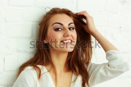 Portré derűs fiatal nő fehér fal lány Stock fotó © deandrobot
