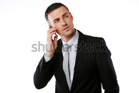 Confident businessman talking on the phone over white background Stock photo © deandrobot