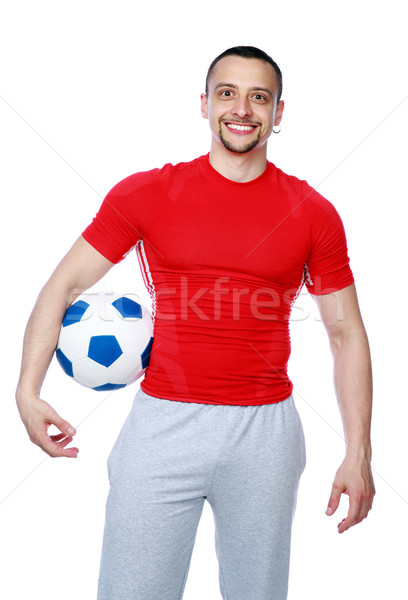 Crazy sportive man holding soccer ball over white background Stock photo © deandrobot
