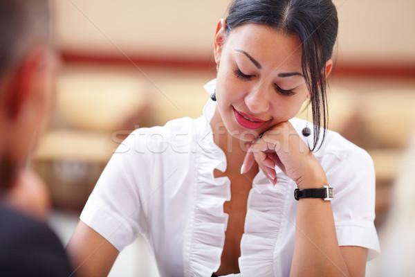 Mosolygó nő ül üzleti megbeszélés kollégák iroda nő Stock fotó © deandrobot