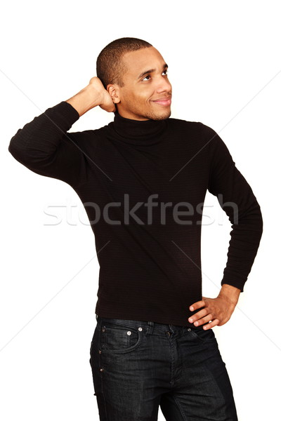 Young handsome african-american man over white background Stock photo © deandrobot