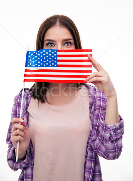 Young student covering her mouth with US flag Stock photo © deandrobot