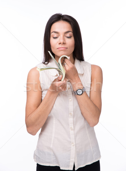 Young businesswoman smelling money Stock photo © deandrobot