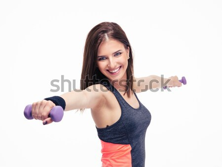 Cheerful woman working out with dumbbells Stock photo © deandrobot