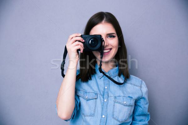 Happy woman making photo on camera Stock photo © deandrobot