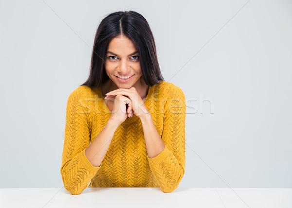Feliz mulher atraente sessão tabela isolado branco Foto stock © deandrobot