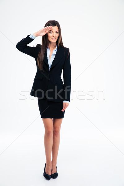 Cute businesswoman saluting Stock photo © deandrobot