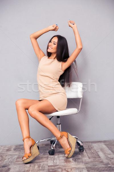 幸せ 女性 座って 事務椅子 グレー 少女 ストックフォト © deandrobot