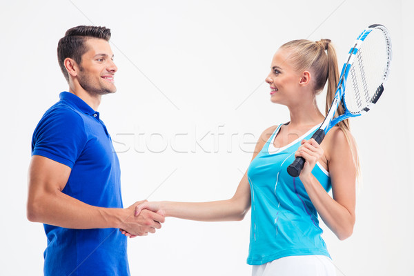 Portrait of a tennis players handshaking Stock photo © deandrobot