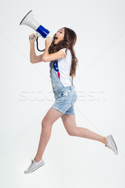 Woman shouting in megaphone Stock photo © deandrobot
