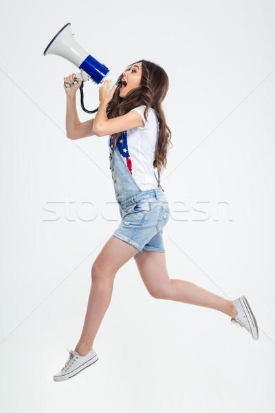 Kadın megafon tam uzunlukta portre genç kadın Stok fotoğraf © deandrobot