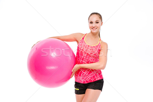 Young sportswoman holding fitball  Stock photo © deandrobot