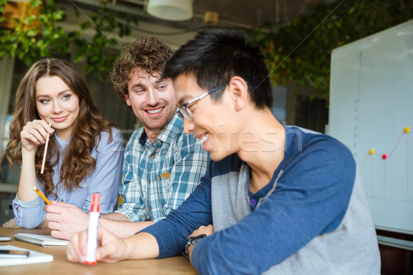 Asian guy feels embarrassed and shy with his friends Stock photo © deandrobot