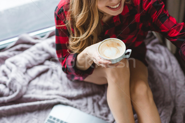 Cheerful woman in chekered shirt drinking cappuccino Stock photo © deandrobot