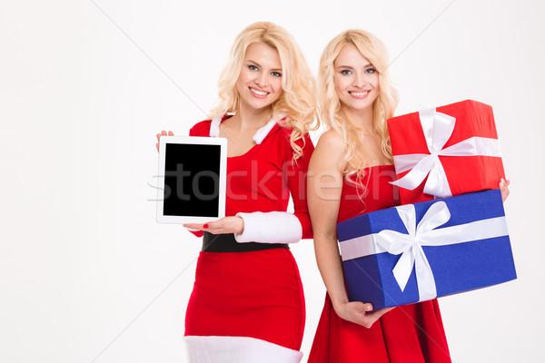 Iki ikizler hediyeler ekran Stok fotoğraf © deandrobot