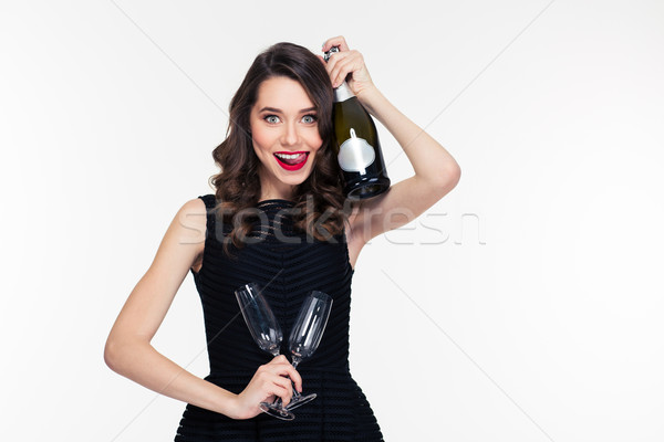 Beautiful smiling woman with bottle of champagne and two glasses Stock photo © deandrobot