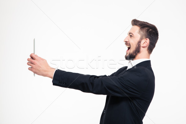 Businessman doing video call on tablet compute Stock photo © deandrobot