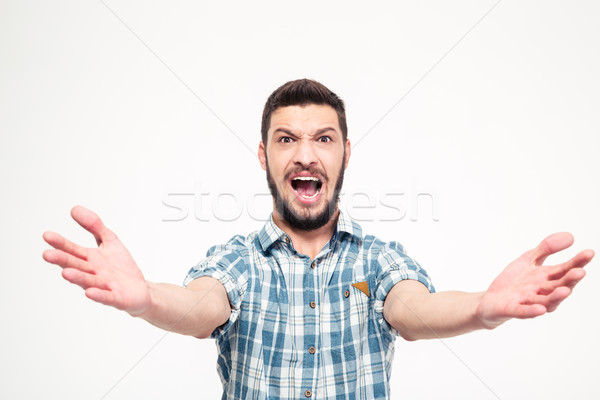 Funny concentrated young man with beard singing loudly Stock photo © deandrobot