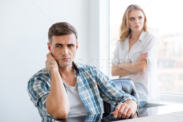Upset man and woman having problems in relationships  Stock photo © deandrobot